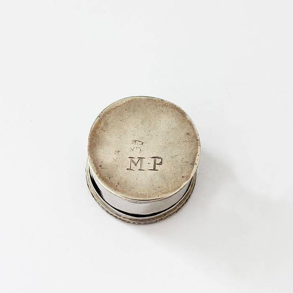 a preowned antique silver circular pill box with a roped edge dating back to the georgian period with initials MP underneath