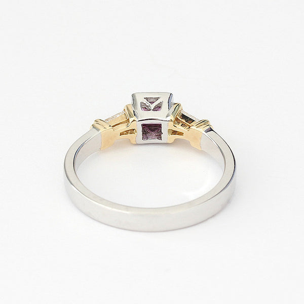 white gold ring with central square pink sapphire and 2 tapered baguette diamonds modern