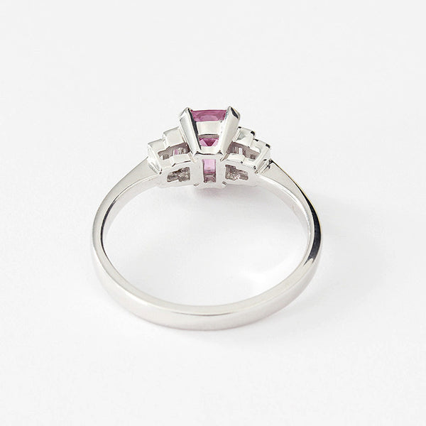 white gold pink sapphire ring with baguette diamond shoulders