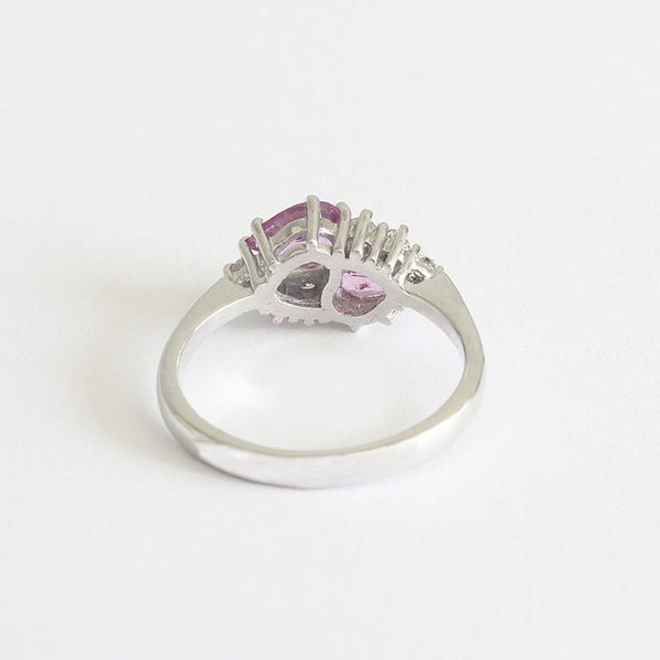 a white gold claw set pink sapphire diamond cluster ring