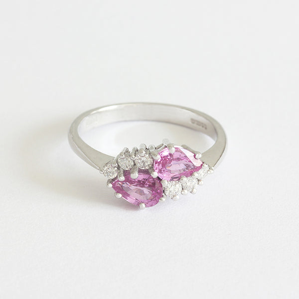 a stunning pink sapphire diamond ring claw set
