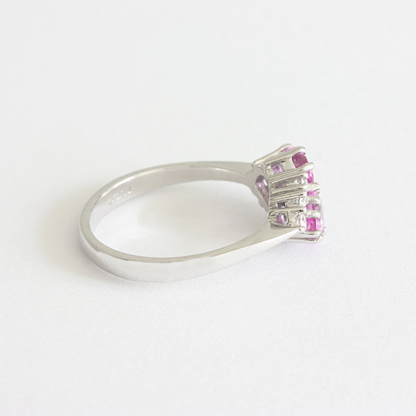 a modern white gold pink sapphire and diamond ring