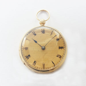 an antique open faced gold fob watch with key winding feature and hallmarked for london 1862