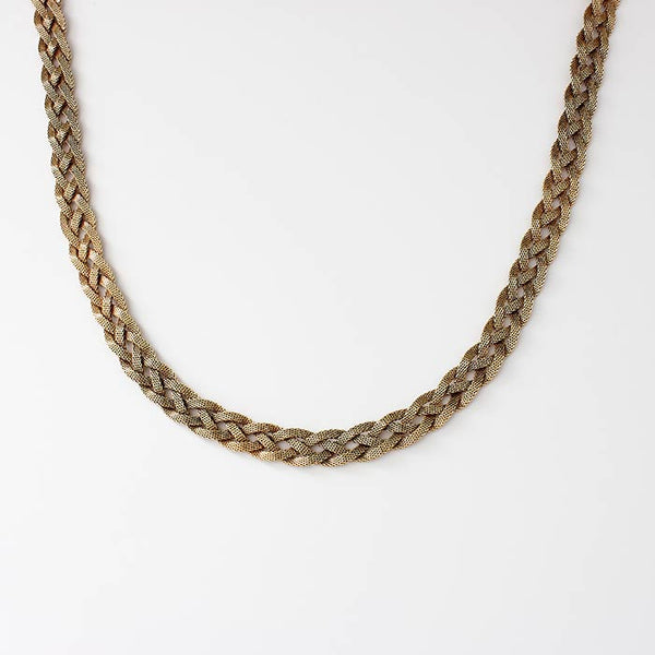a secondhand yellow gold plaited milanese necklace in 14 carat yellow gold dated 1967