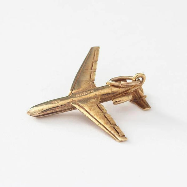 a wonderful vintage aeroplane charm in 9 carat yellow gold