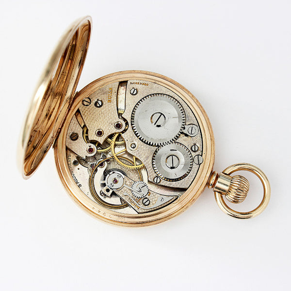 vintage gold pocket watch with an open face and english case with swiss movement