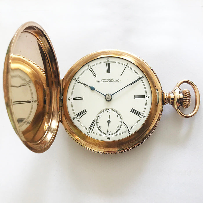 a wonderful American waltham watch company pocket watch in 14 carat gold plate with engraving at Marston Barrett
