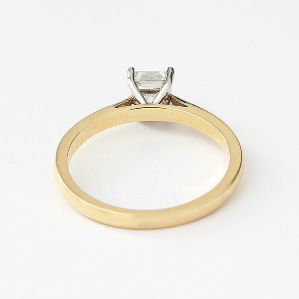 a diamond ring with square stone and 4 claw setting with yellow band and white setting