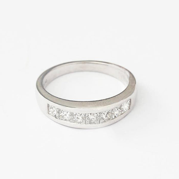 a diamond set princess cut 7 stone half eternity ring in white gold