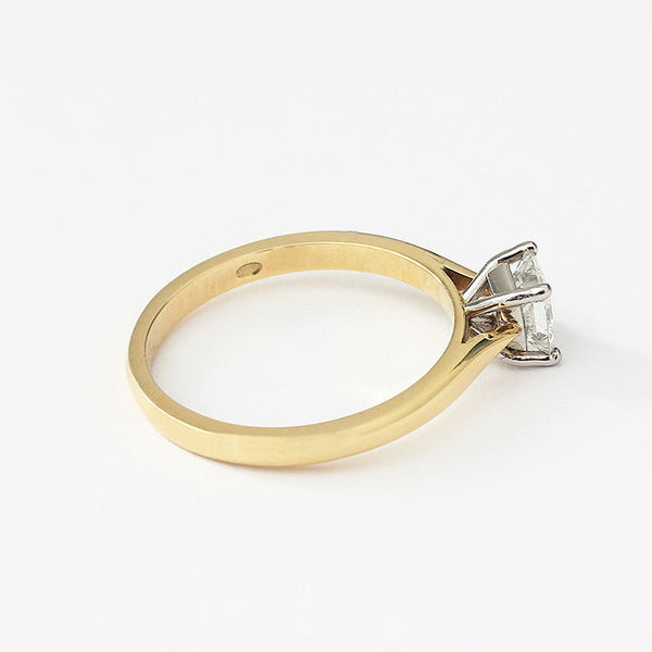a princess cut diamond single stone engagement ring in yellow gold with white gold setting