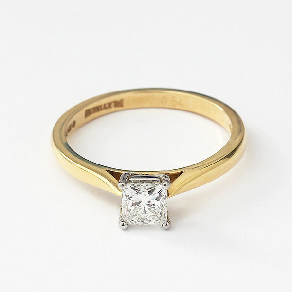 a single stone engagement ring princess cut diamond in white 4 claw setting and yellow gold band