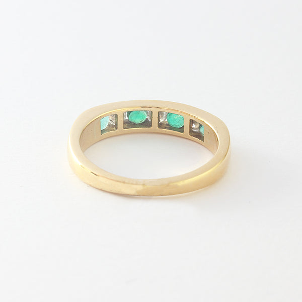 a preowned emerald diamond half eternity channel set ring yellow gold
