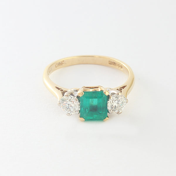 secondhand emerald and diamond ring in yellow gold