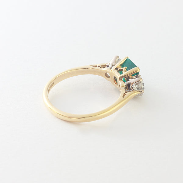 a yellow gold preowned emerald and diamond 3 stone ring