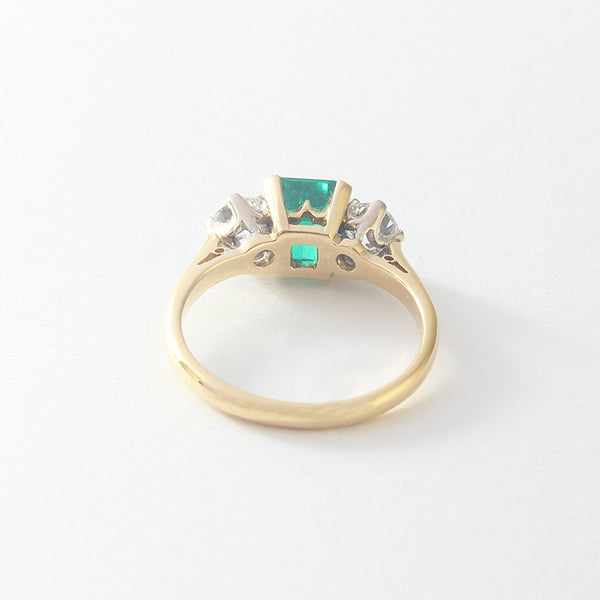 a stunning emerald and diamond 3 stone ring in  yellow gold setting at marston Barrett lewes