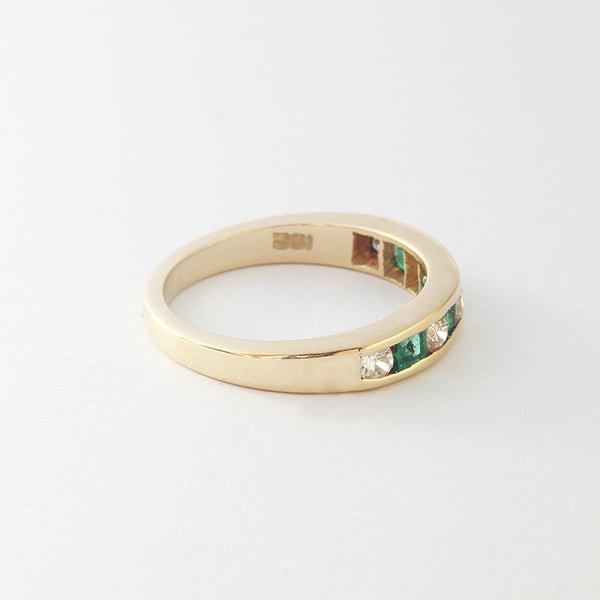 a yellow gold emerald diamond eternity style ring