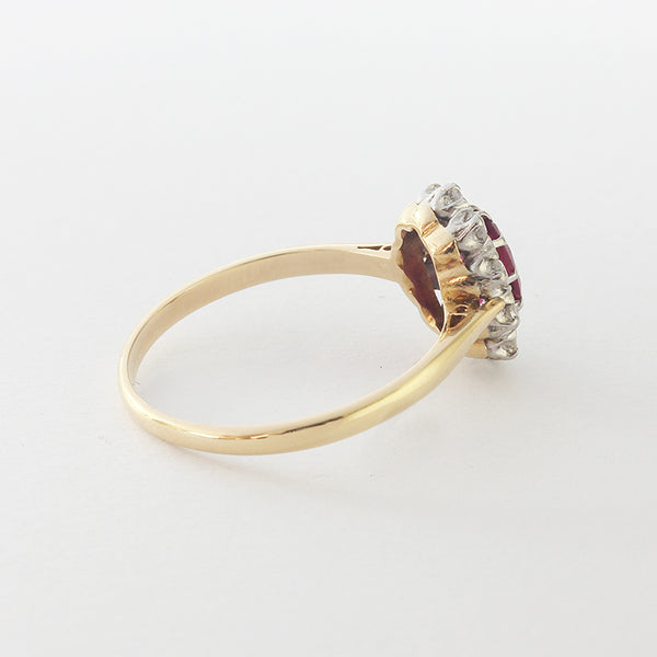 a superb cluster ring in yellow and white with oval ruby and diamond  edges