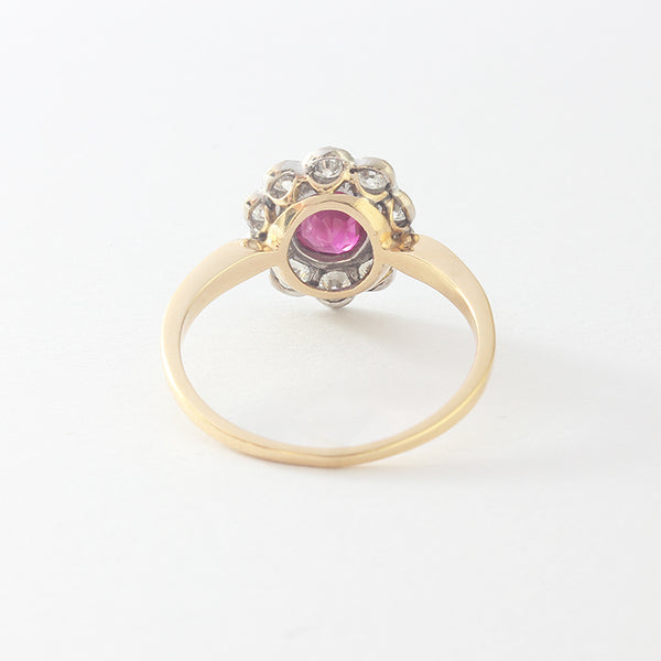 a beautiful ruby and diamond cluster yellow gold ring