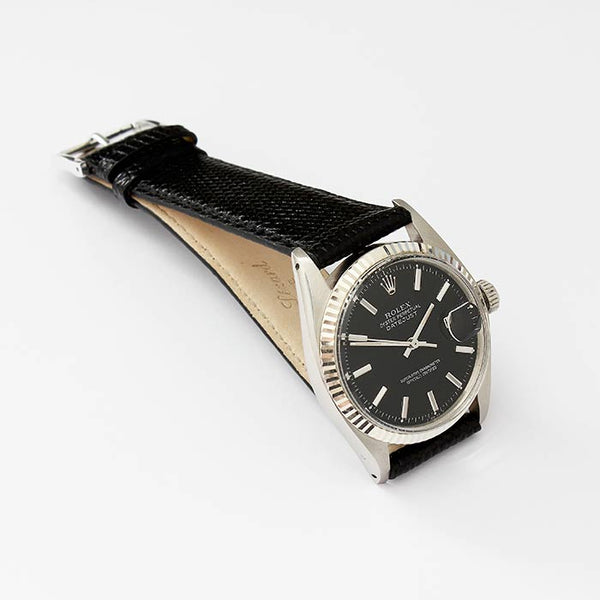 a vintage rolex mens watch with date just feature and oyster perpetual design with modern leather strap