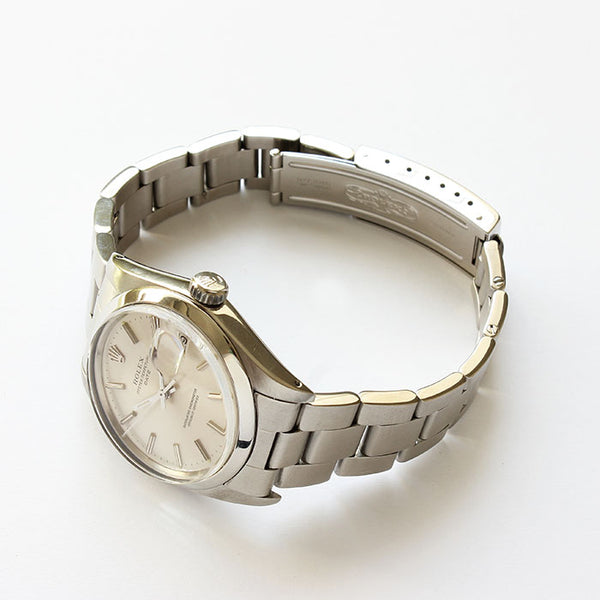 a vintage rolex watch with stainless steel case and bracelet