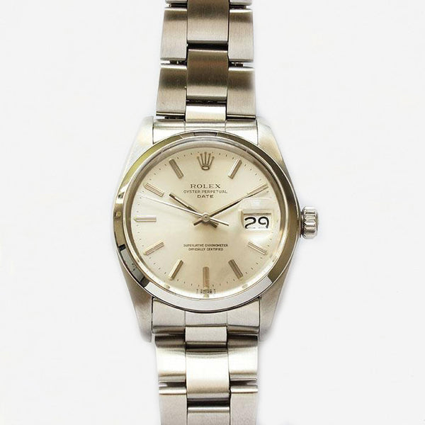 a secondhand vintage mens rolex watch with stainless steel strap and case