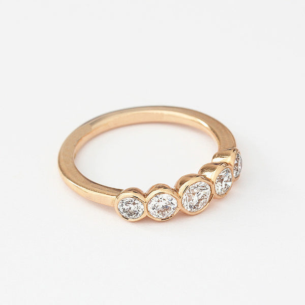 rose gold diamond set 5 stone ring with a rub-over setting