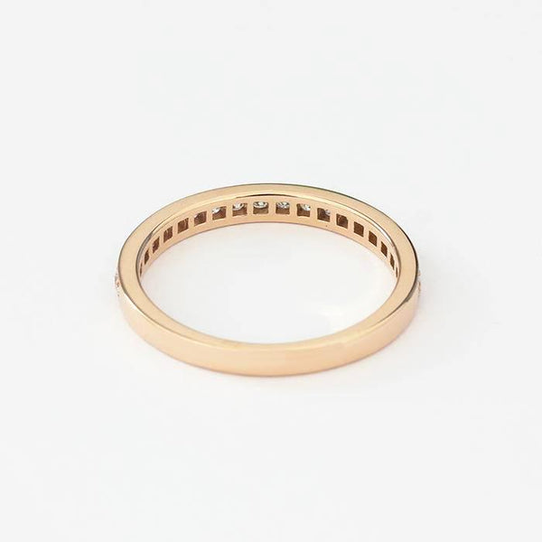 a rose gold diamond set eternity ring with 20 diamonds in a grain setting and 2mm wide band
