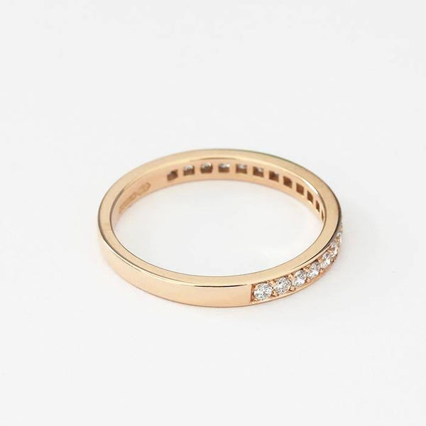 an 18ct rose gold diamond eternity ring with a 2mm band and 20 small round diamonds