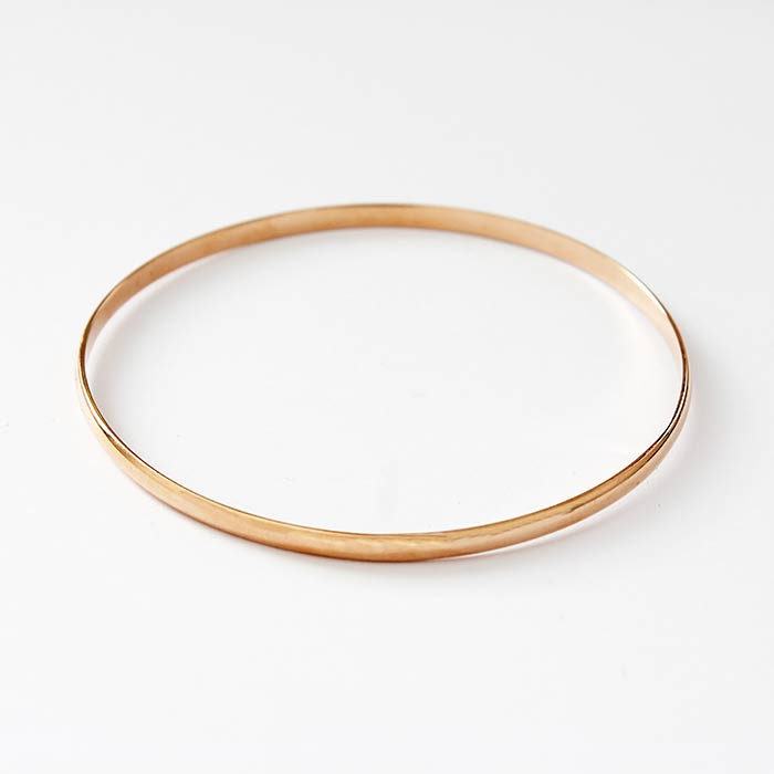 a beautiful 18 carat rose gold plain round solid bangle