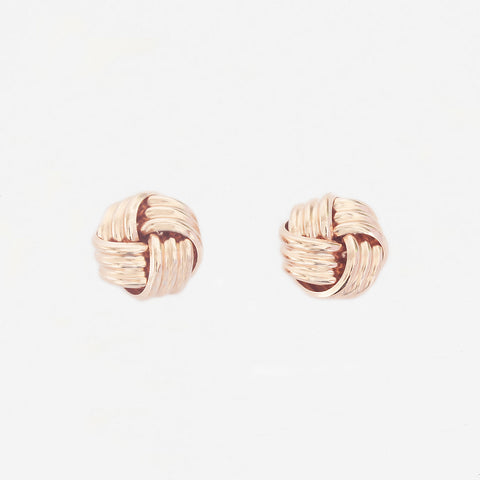 a pair of rose gold knot design stud earrings