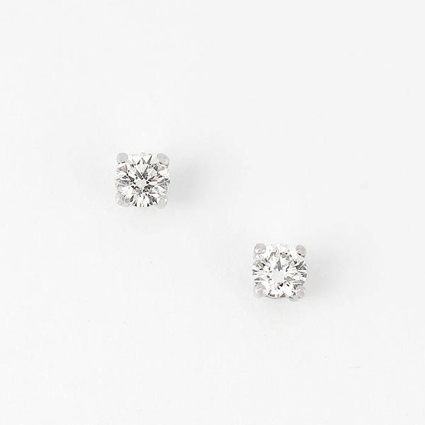 a set of diamond stud earrings with a 4 claw setting and all made in white gold
