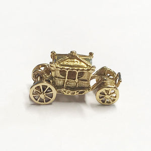 a vintage secondhand royal carriage charm in 9 carat yellow gold