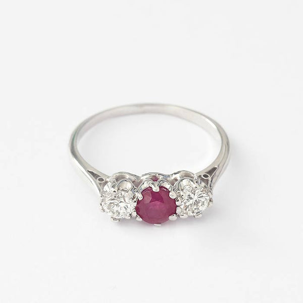 a beautiful secondhand ruby and diamond 3 stone ring with a claw setting and mounted in white gold