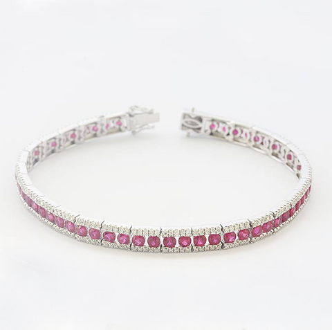 a beautiful ruby and diamond tennis bracelet in white gold