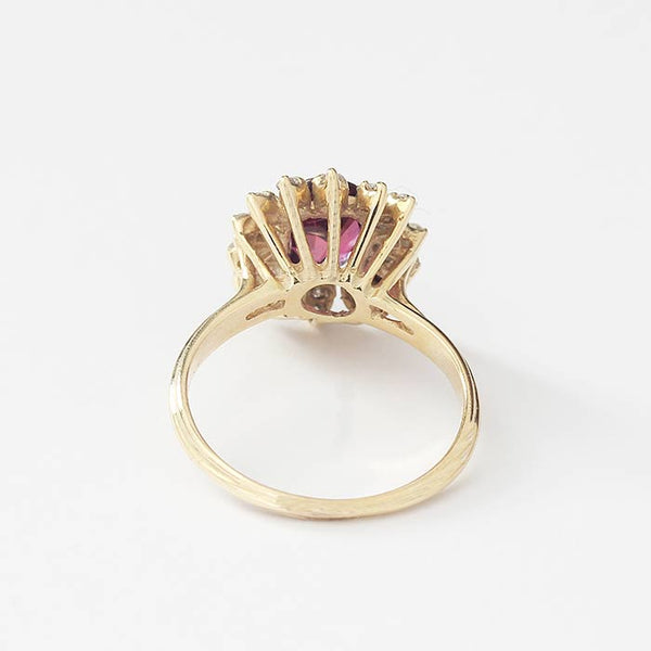 a secondhand ruby and diamond oval cluster ring in yellow gold with claw settings