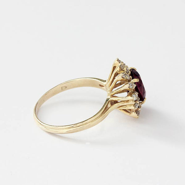 a secondhand vintage ruby and diamond oval cluster ring with claw settings