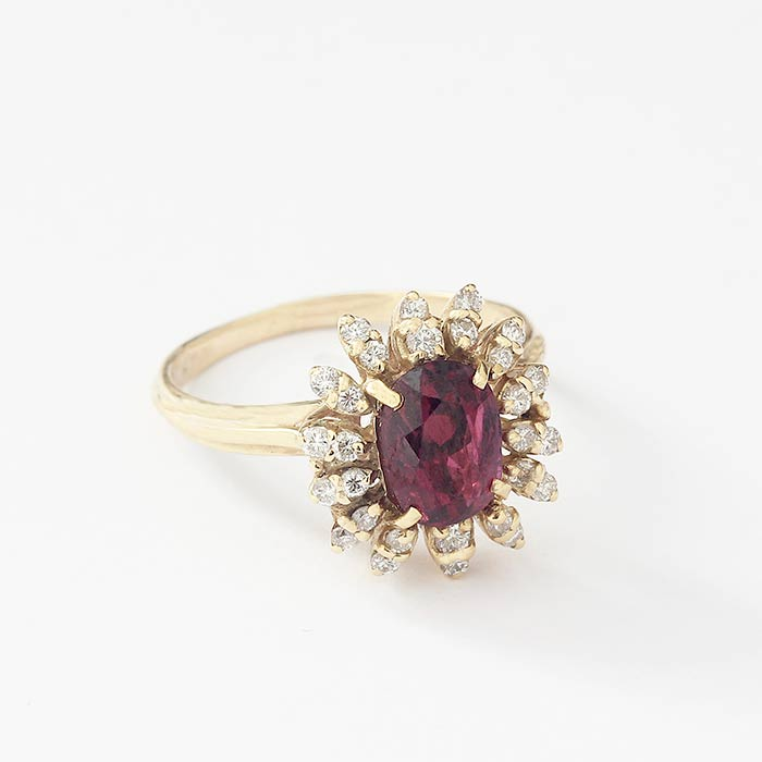 ruby and diamond set cluster oval shaped ring in yellow gold