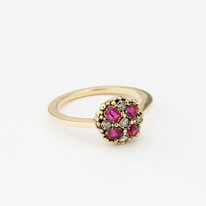 ruby and diamond cluster ring set in yellow gold