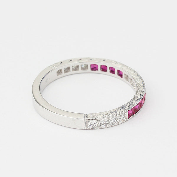 white gold eternity ring with square rubies and round diamonds in channel setting
