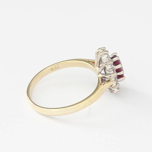 ruby and diamond cluster ring in yellow and white gold with claw settings