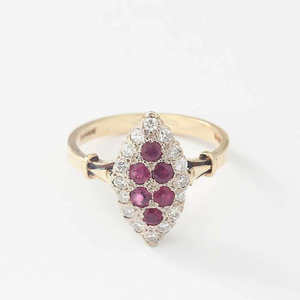 a beautiful ruby and diamond marquise shaped ring in yellow gold