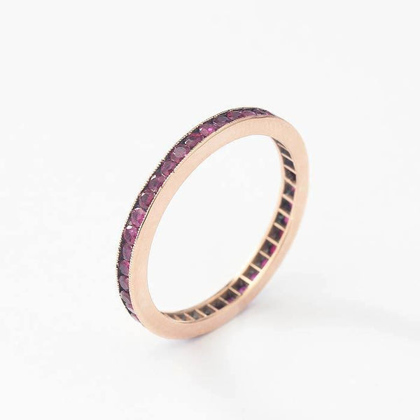 channel set round ruby full eternity ring in rose gold finger size N