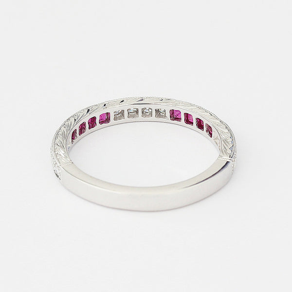 white gold eternity ring with rubies and diamonds in channel setting