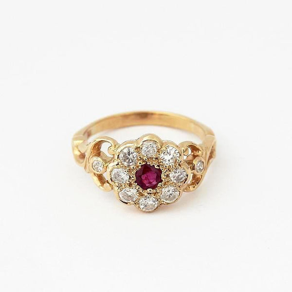 a vintage secondhand ruby and diamond daisy cluster ring in yellow gold