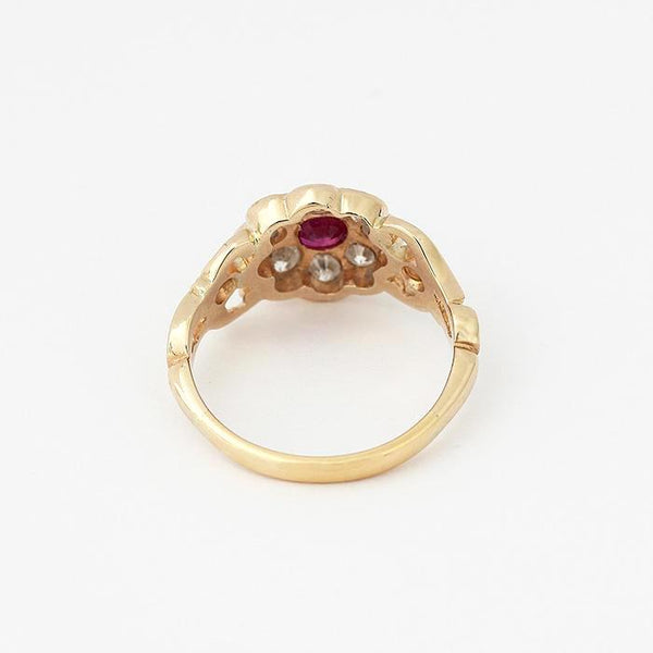a secondhand ruby and diamond daisy cluster ring in a yellow gold band