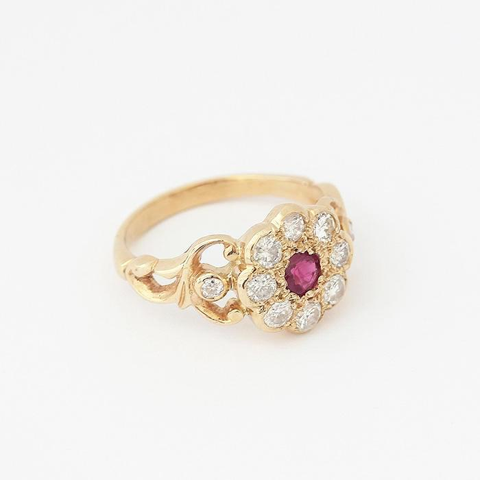 a secondhand ruby and diamond daisy cluster ring in yellow gold