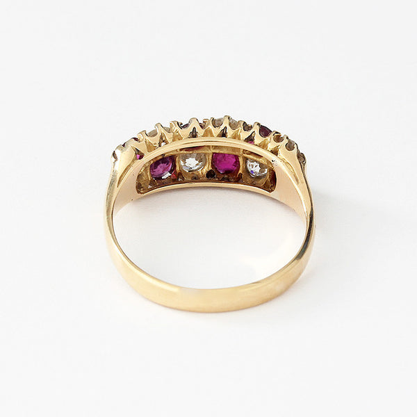 ruby and diamond cluster ring in yellow gold with claws and a checkerboard design