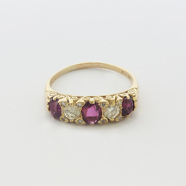 a ruby and diamond carved yellow gold victorian style ring