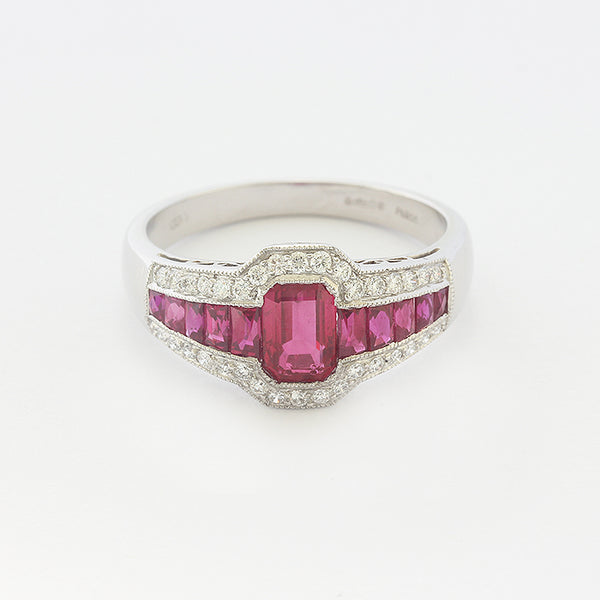 a platinum ruby and diamond cluster set ring