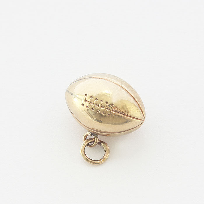 a yellow gold secondhand rugby ball charm